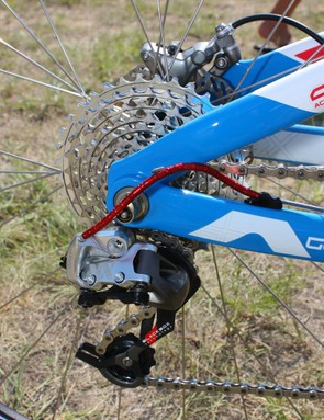 A standard SRAM XX rear derailleur is bolted to the replaceable hanger.