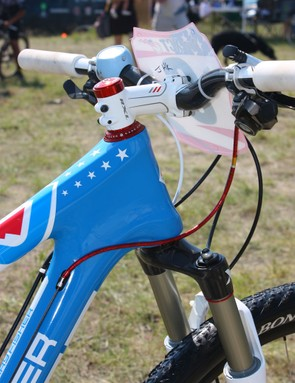 The burly head tube area is topped with a negative-rise stem to offset the riser bar.