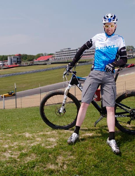 Oli posing by the Indy Circuit motor racing track