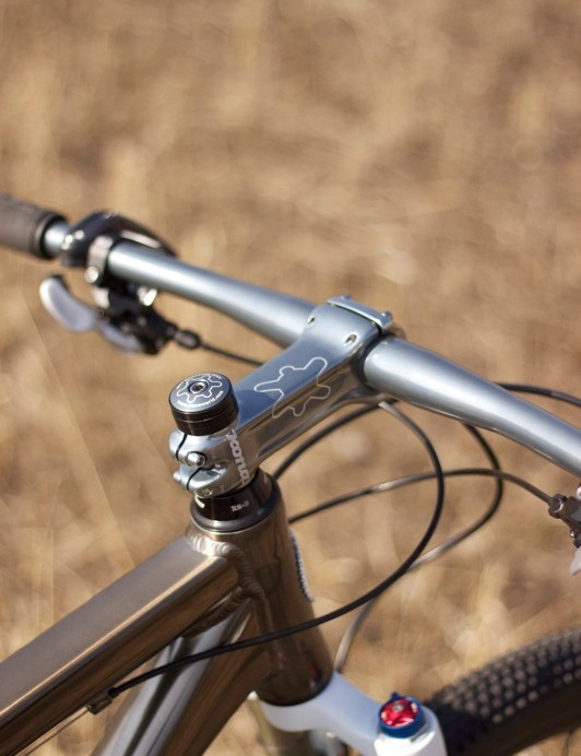 The front end is plenty stiff even without a tapered steerer and head tube