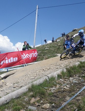 ChainReactionCycles-Intense's Matt Simmonds leaves a trail of dust on the Fort William downhill