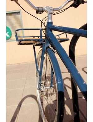 The front rack's styling and construction seemlessly integrates into the frame and fork