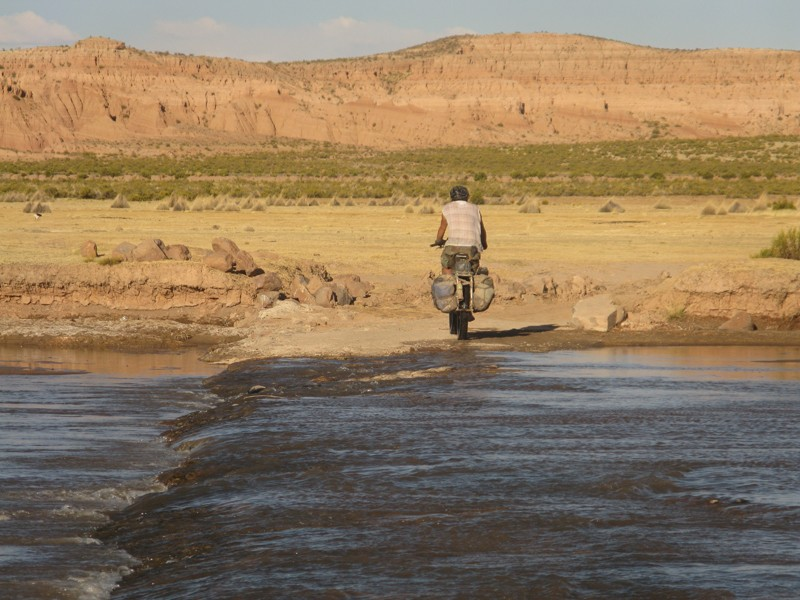 Crossing a river in the Bolivian Altiplano on the way to the Salar de Uyuni
