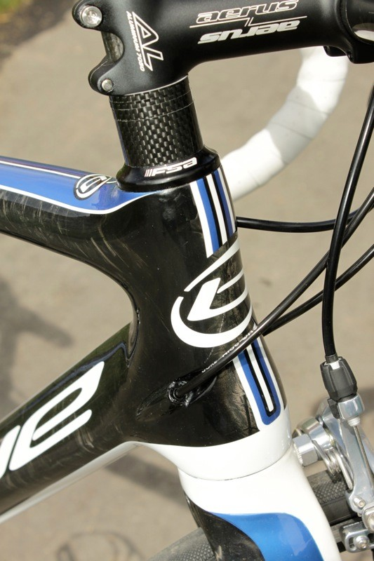 The shifter cables enter just behind the center of the head tube