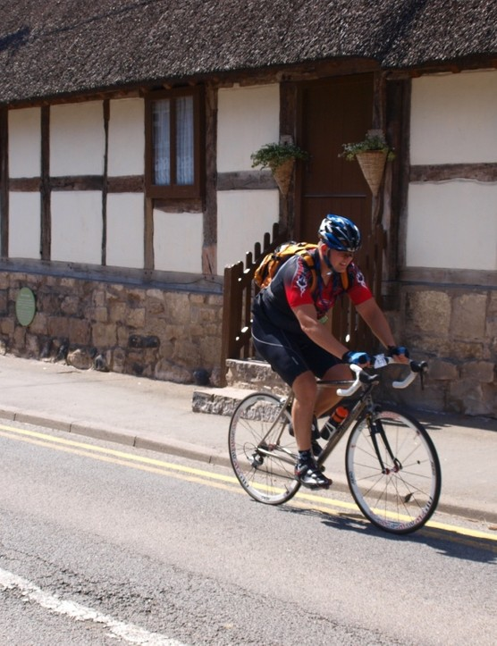 Kevin Last passes a historic cottage in Ruthin