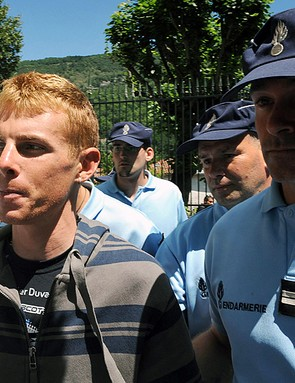 Riccardo Ricco with a French gendarme during the 2008 Tour de France