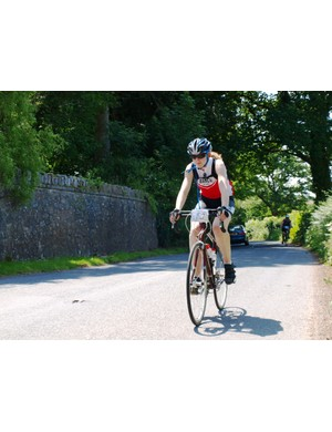 Charlotte Hardy prepares to tackle the final big climb near Doccombe