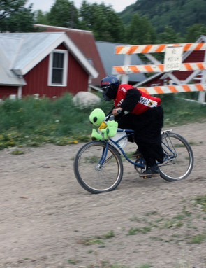 This chainless downhill racer not only donned his own gorilla suit but added an otherworldly passenger, too