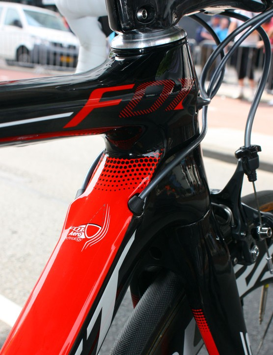 Derailleur cables enter the down tube just aft of the head tube, and the plugs are sized for Shimano Dura-Ace Di2 wires