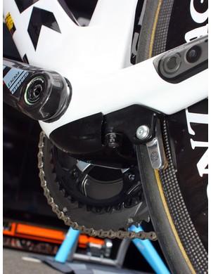 The proprietary rear brake arms are aerodynamically shielded by a small pod beneath the bottom bracket