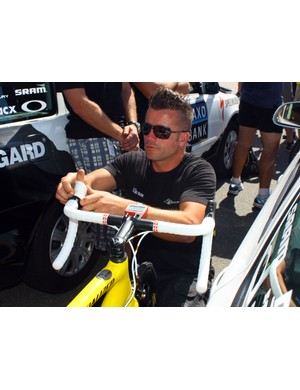 Saxo Bank team mechanic Roger Theel swaps Cancellara's white brake hoods for yellow ones prior to setting off on Stage 1