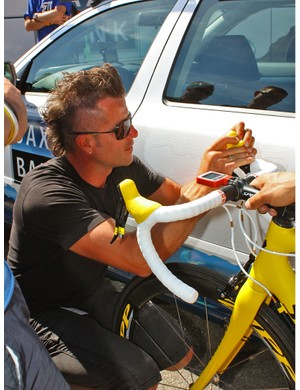 Two hoods off, two hoods on: team mechanic Roger Theel fitted yellow hoods on Cancellara's rig in less than three minutes
