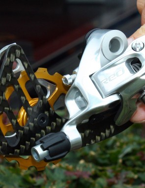 The top SRAM-equipped GC riders in this year's Tour de France are using these special Red rear derailleurs, retrofitted with Berner large-diameter pulleys and cages that supposedly decrease drivetrain drag