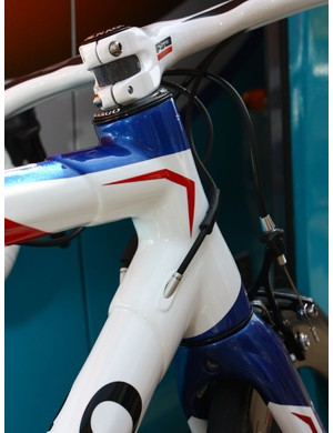 The internally routed derailleur cables enter the frame just behind the tapered head tube
