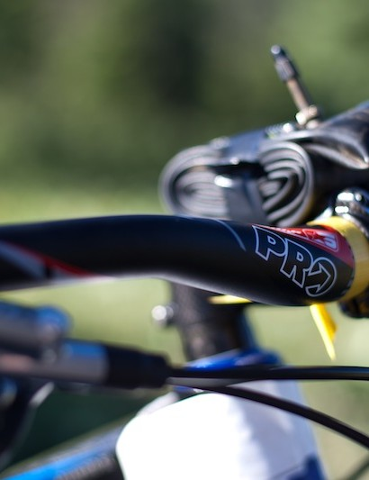 Wide handlebars and a spare tube are necessities for this downhill race