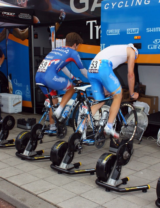 Garmin-Transitions riders are using the new LeMond Revolution trainers for pre-stage warmups. While they're seen atop front wheel riser blocks here, the rear axle of the trainer is situated so that the bike is level when the wheel is resting on the ground