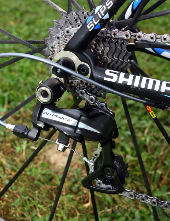 The rear derailleur is mounted to a stout replaceable hanger