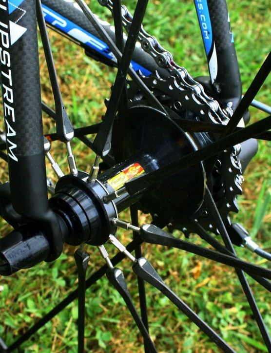 The rear Mavic Cosmic Carbone Ultimate's carbon fibre spokes feature threaded steel ends on the non-drive side to allow for truing