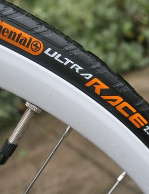White rims and Conti Ultra Race tyres. Fast.