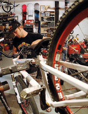 AC gets to grips with his ride at his bike workshop