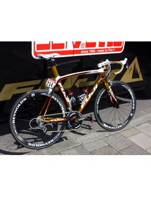 Footon-Servetto's Fuji SSTs are hard to miss with their gleaming gold paint jobs.
