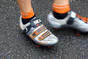 Sidi provides Euskaltel-Euskadi with orange-tinged shoes.