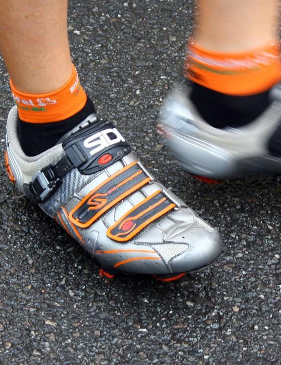 Sidi provides Euskaltel-Euskadi with orange-tinged shoes.