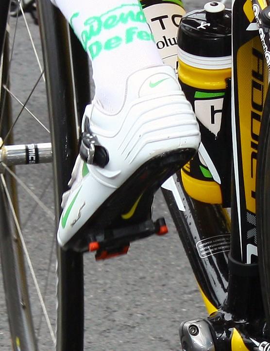 A semi-rigid plastic exoskeleton wraps around the heel and ankle of Mark Cavendish.