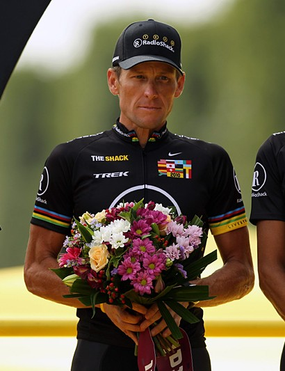 The Radioshack boys in black on the podium, against the UCI's wishes