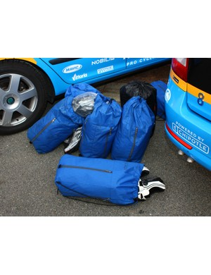 Team soigneurs are busy early in the day, too, with each rider having their own bag of personal stuff for the day.