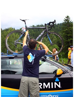 Team mechanic Inaki Goiburu wastes no time in getting Tyler Farrar's bike loaded on top of the team car for the journey to that night's hotel.