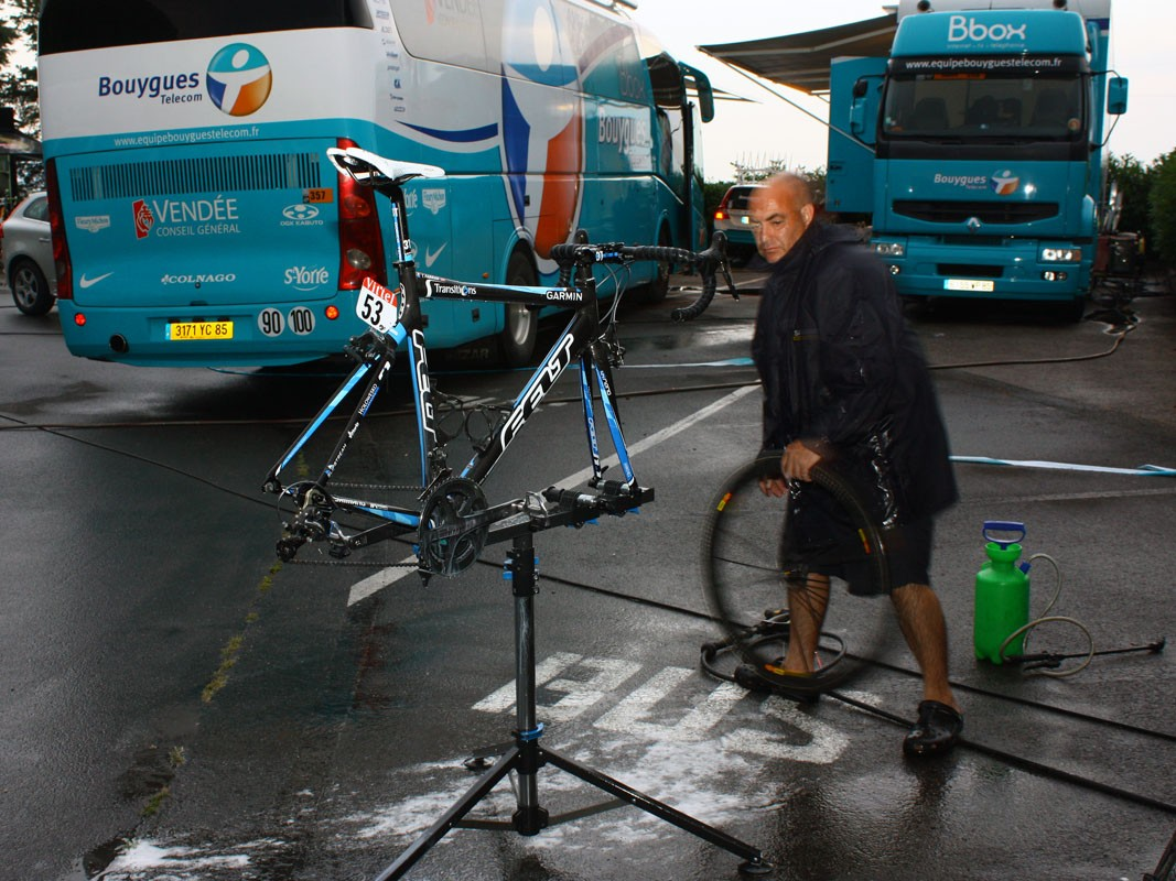 Team mechanic Geoff Brown gets to work cleaning Tyler Farrar's bike.