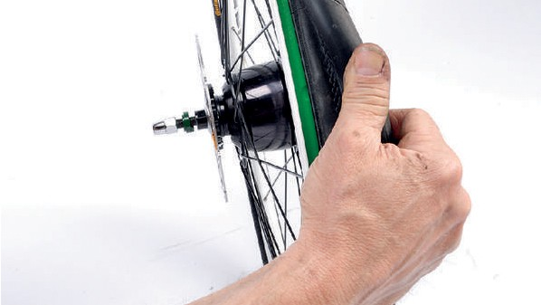 Manoeuvring the tyre into the central channel of the rim can make wrestling it off a little easier