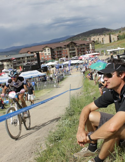 Marc Gullickson looks on as Jeremy Horgan Kobelski suffers up the steepest climb on the Sol Vista national's course