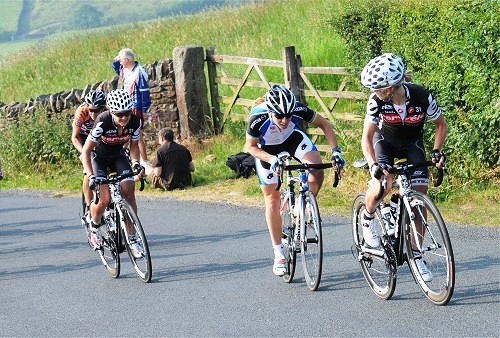 Eventual national road race champion Emma Pooley attacks but Sharon, left, and Nicole Cooke respond