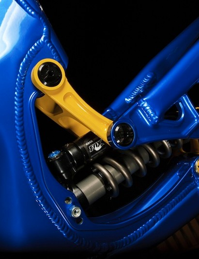 The front shock mounts allow adjustment to the linkage rate of the bike