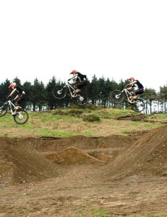 DMR's Duncan Ferris jumping a 10-metre double at the new Afan four-cross track
