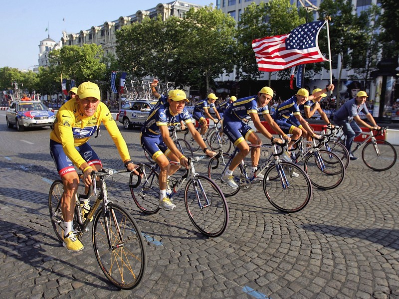 Lance Armstrong faces doping accusations from another former US Postal Service team-mate. Here he's pictured with the squad after winning the 2004 Tour de France