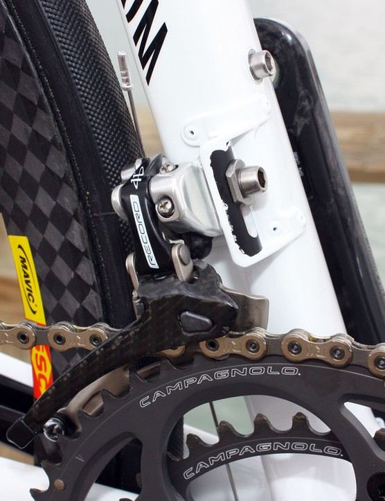 The Campagnolo Record front derailleur is bolted to a stout four-rivet mount