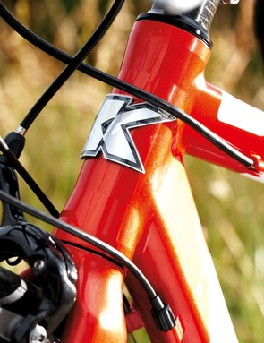 The short head tube immediately gives away the bike's racing roots and puts you in a great, low riding position
