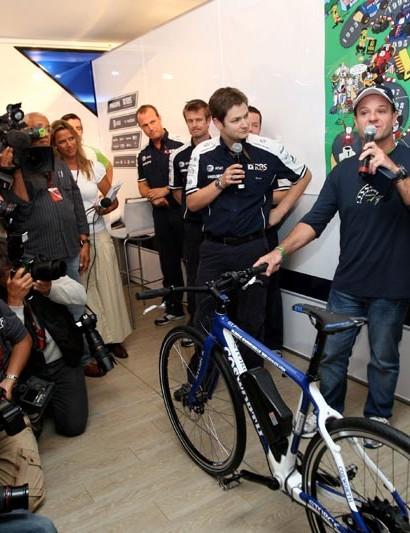Rubens Barichello receives the bike