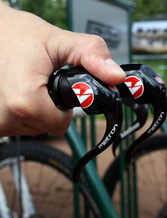 To release cable, rest your thumb over the end of the lever body and push it like a button