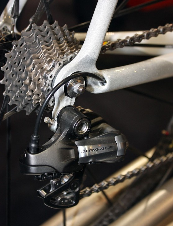 The rear derailleur wire runs through the chainstay