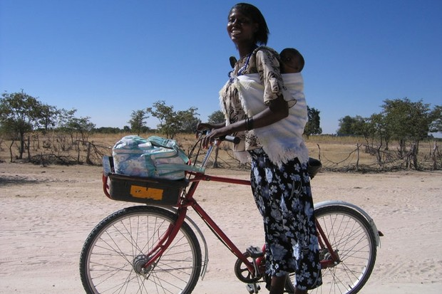 A Namibian woman enjoys the benefits of her donated bicycle from BEN Namibia