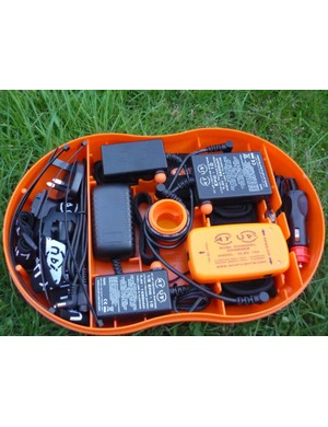 The lower deck holds the batteries and charger