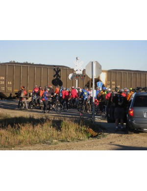 The ride was caught behind a train just a few miles after the start