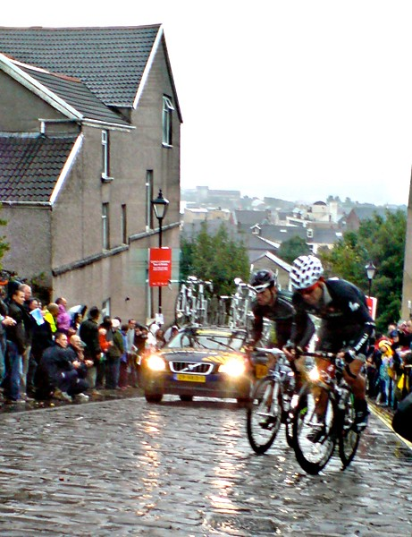 Riders scale Constitution Hill in Swansea on Monday's wet stage three