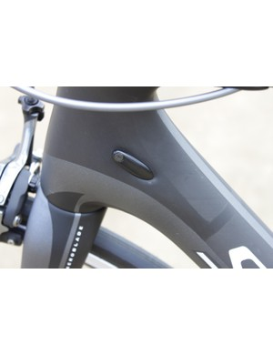 The front derailleur cable port is plugged for use with Shimano Di2