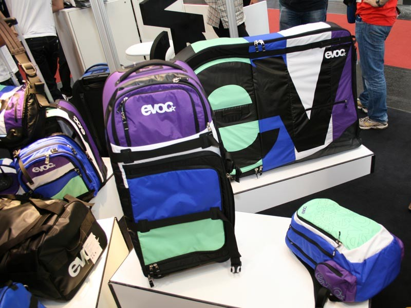 EVOC travel case and collection in purple, blue and green