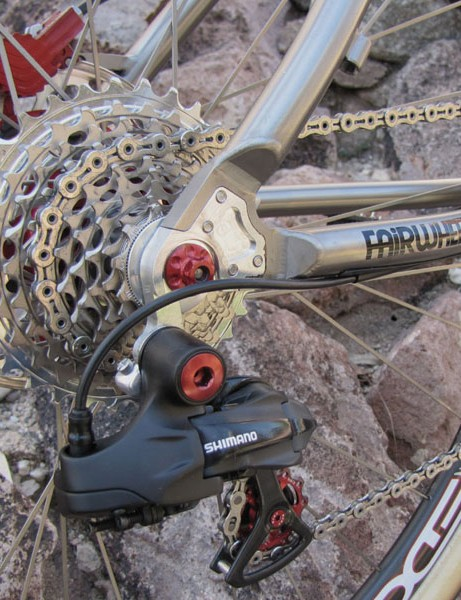 The tuned Di2 rear derailleur moves the KMC chain across a SRAM XX cassette